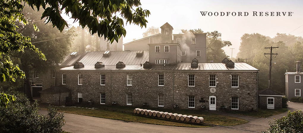 Woodford Reserve distillery grey stone building with leafy frame