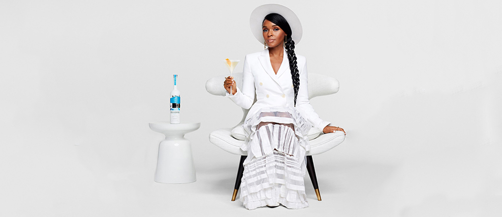 Janelle Monae seated next to Belvedere bottle